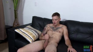 Military inked stud wanking his cock on couch